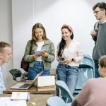 Young people in an office talking and laughing