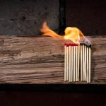 Matches burning on a piece of wood
